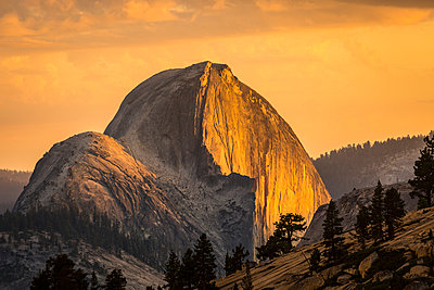 Half Dome at sunset during the Meadow Fire, as seen from near Olmsted Point along the Tioga Pass Road in Yosemite National Park; California, United States of America - p442m1086756 by Tracy Barbutes