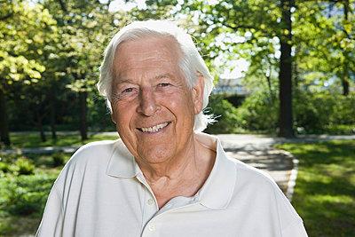 A portrait of a senior man, outdoors - p30118540f by Paul Hudson