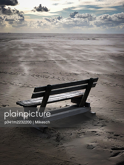 Germany, Bench on the beach - p341m2232200 by Mikesch