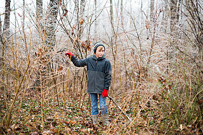 Boy in ice covered woods - p1169m2108467 by Tytia Habing