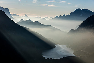 Mist on peaks of Dolomites and Monte Civetta seen from Cima Belvedere at dawn, Val di Fassa, Trentino-Alto Adige, Italy, Europe - p871m1221563 by Roberto Moiola