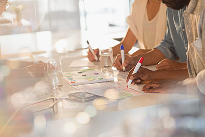 Creative business people brainstorming, planning - p1023m1561202 by Tom Merton