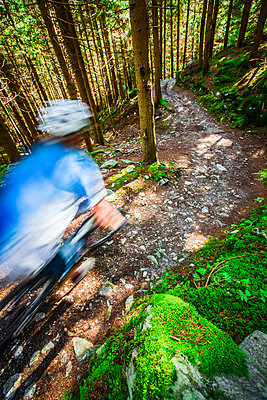 Mountain bike rider blurred from speed when riding the trails of Chamonix, France. - p343m1090330 by Elias Kunosson