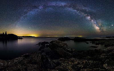 Milky way over rugged coastline - p343m1475834 by Adam Woodworth