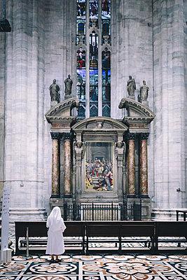 A nun examines the interior of the Milan Duomo Cathedral. - p343m1088788 by Joel Addams
