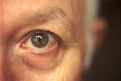 Close up of elderly man's eye - p3721341 by John Mattison