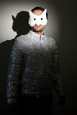 Man with mask - p0750348 by Lukasz Chrobok