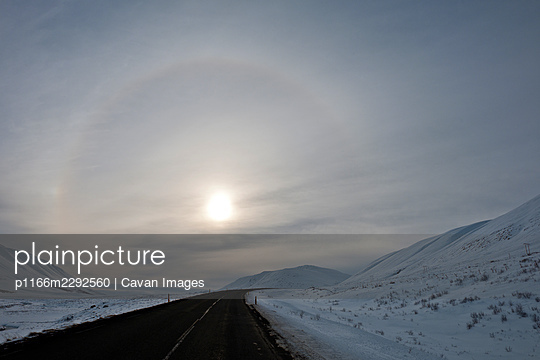 Sun with halo  on the no 1 highway in north Iceland - p1166m2292560 by Cavan Images