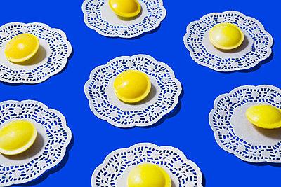 Fizzy candy on lace doily - p1149m2127144 by Yvonne Röder