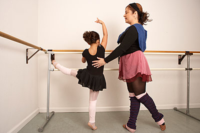 Girl working with ballet teacher - p555m1420371 by Tanya Constantine