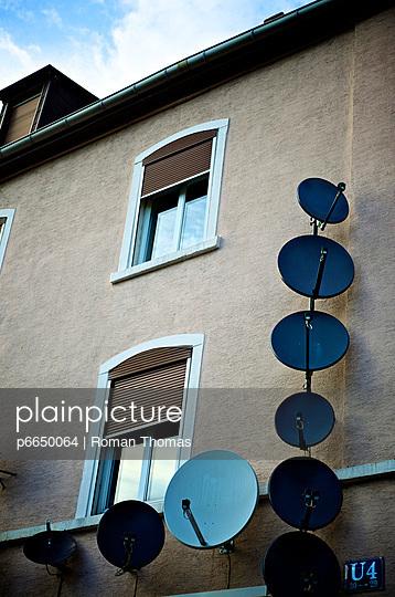 House with satellite dish - p6650064 by Roman Thomas