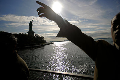 Showing the direction on the ferry boat to the Statue of Liberty, NYC - p1028m1207600 by Jean Marmeisse