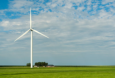 Windturbine and farm - p1132m1591235 by Mischa Keijser