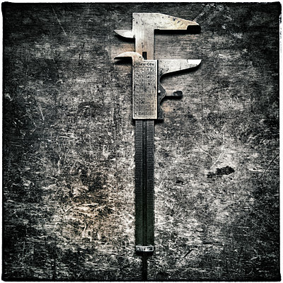 A Carpenters Caliper - p1154m967864 by Tom Hogan