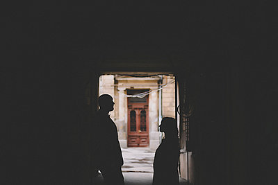 Silhouettes of newlywed standing in gate - p1427m2200183 by Kateryna Soroka