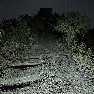 Deserted gravel track at night, Mallorca - p1624m2195925 by Gabriela Torres Ruiz