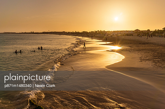 Sunset at the beach in Santa Maria, Praia de Santa Maria, Baia de Santa Maria, Sal Island, Cape Verde, Atlantic, Africa - p871m1480340 by Neale Clark