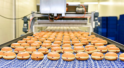 Production line in a baking factory with Berliners - p300m1176005 by lyzs