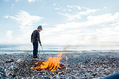Boy Building Beach Bonfire - p1262m1083652 by Maryanne Gobble
