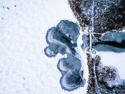Aerial view of frozen lake in winter, South Kingstown, Rhode Island, USA - p343m1585194 by Cate Brown