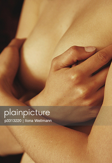 Close-up of a woman cupping her breasts - p3313220 by Ilona Wellmann