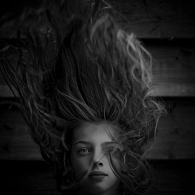 Girl with blowing hair - p896m835667 by Richard Brocken