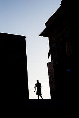 Silhouette Of A Woman With A Camera Between The Two Facades    - p847m1102455 by Johan Strindberg