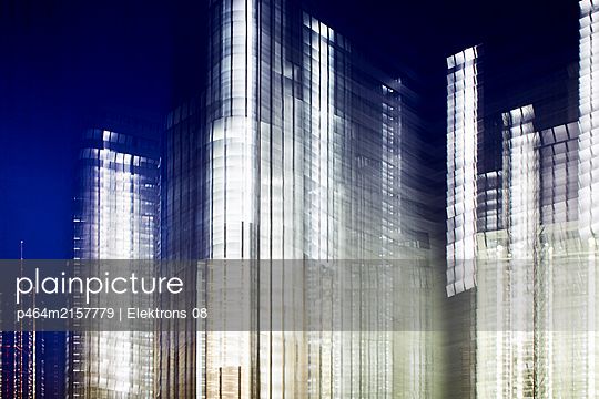 Illuminated office buildings - p464m2157779 by Elektrons 08