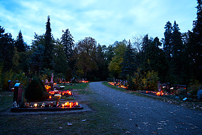All saints, graveyard with lit candles at twilight - p1312m2193650 by Axel Killian
