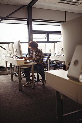 Sound engineer working in studio - p1315m1422255 by Wavebreak