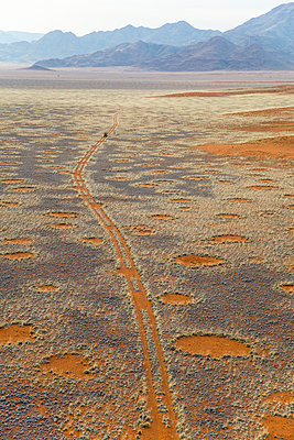 Land Rover on deserted track in the Namib Desert, Namibia, Africa - p871m1067077f by Neil Emmerson