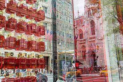 Buildings reflecting in shop window - p1057m1466830 by Stephen Shepherd