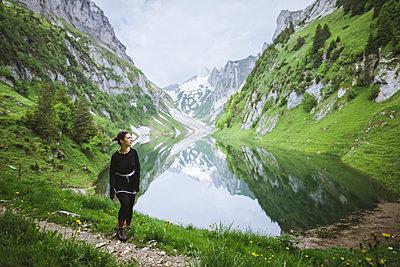 Woman by mountains and lake in Appenzell, Switzerland - p1427m2163645 by Oleksii Karamanov
