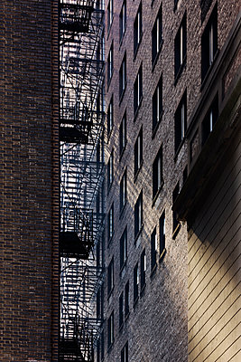 City Alleyway Between Two Apartment Buildings - p1100m2090940 by Mint Images
