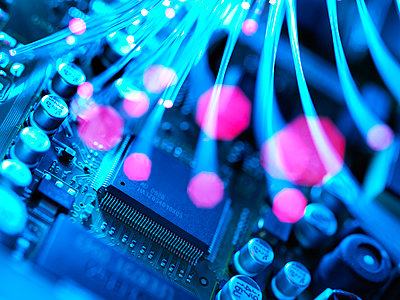 Fibre optics carrying data passing across electronic circuit board - p300m2131648 by Andrew Brookes