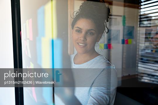 Creatives working in an office - p1315m2162436 by Wavebreak