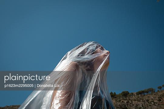 Girl under a plastic foil - p1623m2295005 by Donatella Loi