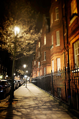 London street at night  - p1072m829293 by Neville Mountford-Hoare