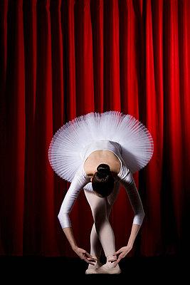 A ballet dancer posing on stage - p30110694f by Iris Friedrich