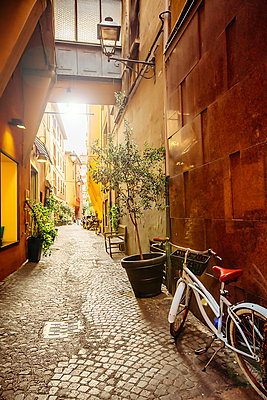 Bicycle in cobblestone alley, Bologna, Emilia-Romagna, Italy - p555m1303883 by Inti St Clair