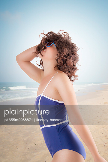 A Happy Woman On The Beach - p1655m2288871 by lindsay basson