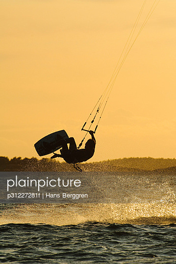 Kite surfing at dusk