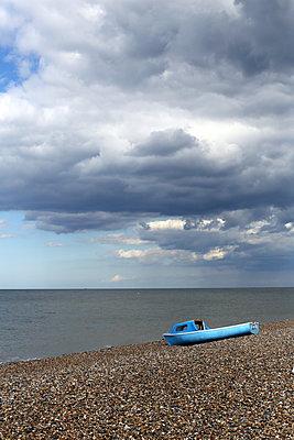 Blue boat on beach - p1063m1134989 by Ekaterina Vasilyeva
