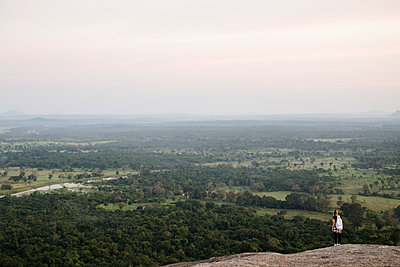 Girl at Sigiriya Rock looks out on lowlands - p1351m1444715 by Janine Meyer
