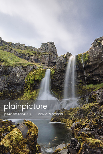 Waterfalls in Mjoifjordur fjord - p1487m1564207 by Ludovic Mornand