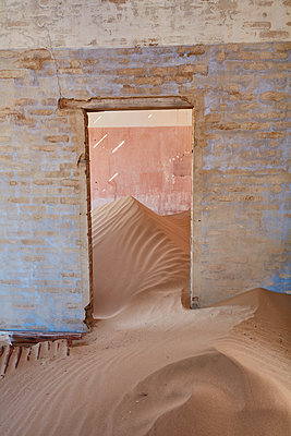 A view of a room in a derelict building full of sand. - p1100m1489978 by Mint Images