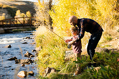 Father and son fishing together - p1427m2169193 by Jessica Peterson