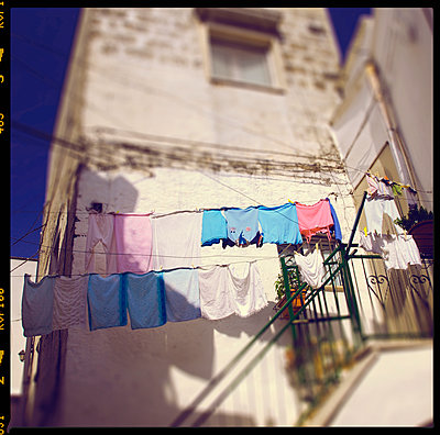 Italy, Clothes Hanging On Clothesline  - p1072m2152919 by Neville Mountford-Hoare