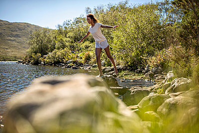 Young woman on a riverbank - p1355m1574222 by Tomasrodriguez