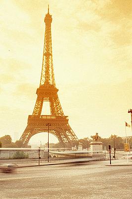 France, Paris, Eiffel tower against sky, low angle view - p4340232f by Oscar Knott
